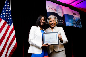 Representative Joyce Beatty (OH-3rd) presenting Dominiq Dudley the Rising Entrepreneur award for READY Publication in Columbus, OH.